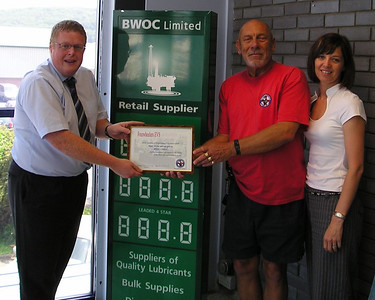 Saying thankyou to BWOC - John Graves  presents a certificate of thanks to BWOC managing director Mark Wayne and his executive assistant Nikki Corrick