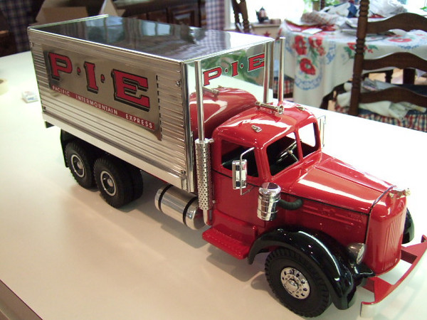 Custom Smith Miller Lmack PIE truck.  A custom PIE pup trailer can be attached to the truck.  The custom wheels have individual lug nuts and lug bolts.