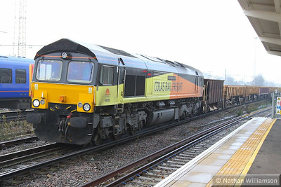 66850 heads east through Clapham Junction on the: 6Y41 09:02 Eastleigh Yard to Hoo Junction Yard  12/12/13