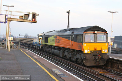 66850 heads west through Clapham Junction on the: 7Y42 13:57 Hoo Junction Yard to Eastleigh Yard  12/12/13