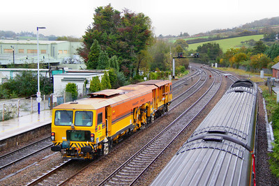 DR73907, Colas Switch & Crossing Tamper heads north through Totnes on the: 6J89 10:02 Liskeard to Exeter St Davids 04/11/11
