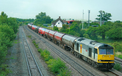 60013 heads west through Magor on the: 6B47 17:42 Westerleigh to Robeston  06/07/09