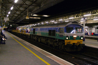59005 heads west through Exeter St Davids on the: 6W30 17:53 Westbury to Hemerdon  17/03/12  Watch the video at: http://youtu.be/8xiNIMjqLjg
