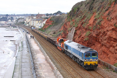 59002 top & tailed with 59001 head north along the Dawlish Sea Wall passing Rockstone Bridge working the: 7W43 11:00 Newton Abbot West Junction to Westbury 24/02/13  Watch the video at: http://youtu.be/tbBMswxSm80