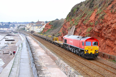 59206 heads north along the Dawlish Sea Wall passing Rockstone Bridge working the: 6W42 10:00 Newton Abbot West Junction to Westbury 24/02/13  Watch the video at: http://youtu.be/ydvd9I9G_Yk