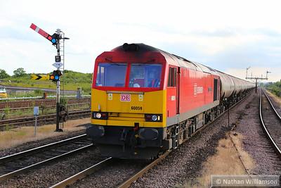 60059 heads east through Barnetby on: 6E41 11:41 Westerleigh to Lindsey  19/06/14