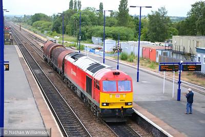 60063 heads east through Barnetby on: 6E08 13:03 Wolverhampton Steel Terminal to Immingham  19/06/14