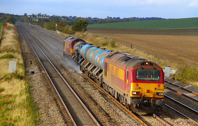67027 heads east through Cholsey in a lucky patch of sun on the: 3J41 15:18 Didcot Yard to Southall via Westbury  19/10/11