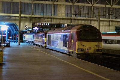 67004 + 90029 + 66108 head north through Carlisle on the: 0K52 14:03 Warrington Aprley to Carlisle Yard  21/11/11