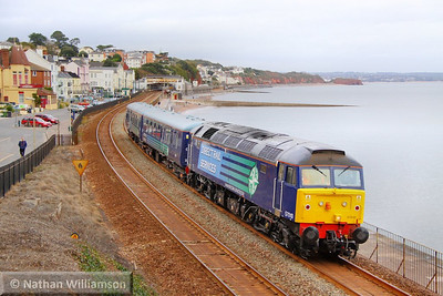 57010 heads west through Dawlish with a pair of nuclear escort coaches, forming the: 5Z71 09:55 Gresty Bridge to Keyham Devonport Dockyard 18/10/10  Watch the video at: http://youtu.be/MQcbrPLkZNM
