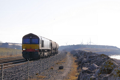 66428 heads north through Siddick on the: 6C42 13:38 Sellafield to Carlisle Yard acid tanks  04/03/10