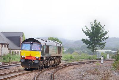 66422 heads west through Newton Abbot on the: 0Z70 04:08 Gresty Bridge to Plymouth  03/08/10