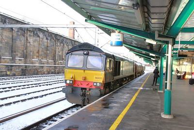 66433 heads south through Carlisle on the: 6Z24 12:00 Carlisle Yard to Sellafield  29/11/10