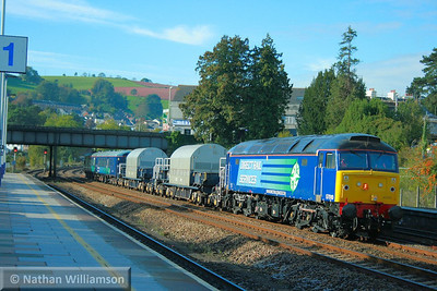 57010 heads north through Totnes with 2 nuclear flasks and 2 escort coaches, forming the: 6X50 09:35 Keyham Devonport Dockyard to Kingmoor  21/10/10