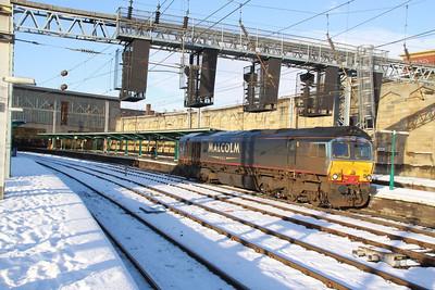 66412 heads south through Carlisle light engine on the: 0Z66 13:37 Kingmoor to Daventry  02/12/10