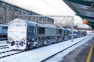 66416 caked in snow calls at Carlisle on the rear of the: 3J06 16:15 Kingmoor to Carlisle  01/12/10