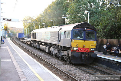 66422 heads east through Kensal Rise on the: 4L48 12:37 Daventry to Tilbury  14/11/13