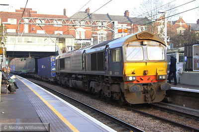 66301 heads west through Kensal Rise on the: 4M71 11:29 Purfleet to Daventry  12/12/13