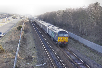 57012 arrives into Workington North, viewed from the Footbridge on the: 2T34 15:50 Workington to Maryport  04/03/10