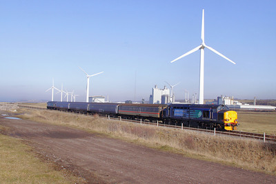 37423 heads south through Siddick Wind Farm on the: 2Z31 14:00 Maryport to Workington 04/03/10  View the video at: http://www.youtube.com/watch?v=bcTbSvw1oyg