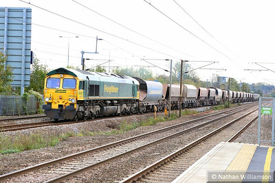 66560 heads north through Mill Hill Broadway on the: 6M32 09:47 Neasden to Bardon  07/11/3