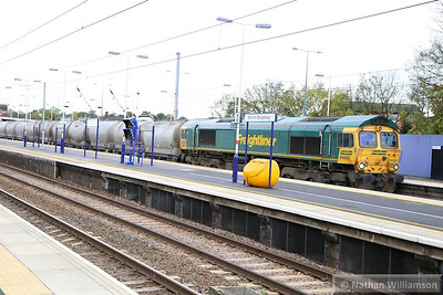 66622 heads south through Mill Hill Broadway on the: 6V94 07:35 Earles Sidings to Theale  07/11/13