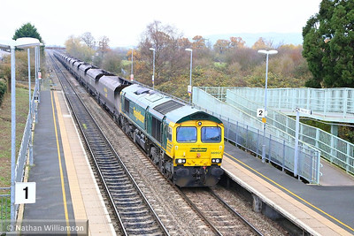 66957 heads south through Ashchurch working the: 4V06 08:52 Rugeley Power Station to Stoke Gifford  03/12/13
