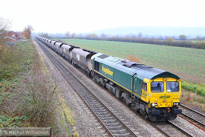 66953 heads south through Ashchurch working the: 4V47 11:15 Rugeley Power Station to Stoke Gifford  03/1/213