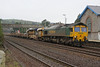 66533 heads north through Totnes working the:<br /> 6Y97 08:30 Liskeard to Westbury via Lostwithiel<br /> <br /> This was the first time Intermodal 66533 had visited Devon<br /> <br /> 06/01/03