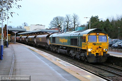 66548 heads south through Cheltenham on the: 4Z72 12:13 Rugeley Power Station to Stoke Gifford  16/12/13