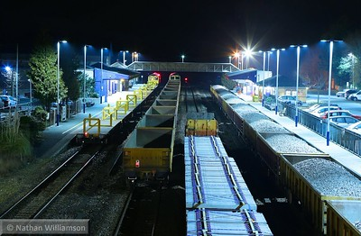 Totnes station was filled with engineers trains at 04:38am with a track renewal at Dainton tunnel. In platform 1 was 70809 which had arrived on 6C21 00:35 Westbury to Totnes. In the down through road was 66060 which had arrived on 6W26 01:55 Westbury to Totnes. On the up through road was 66555 which had worked 6Y53 23:31 Westbury to Totnes via Plymouth and 66564 was on Platform 2 which had worked 6Y52 23:01 Westbury to Totnes via Plymouth  21/03/15