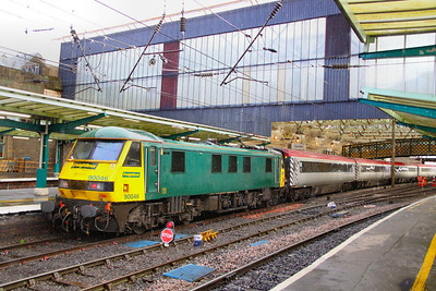 90046 calls at Carlisle on a private charter for Omega Travel working the: 1T90 09:12 Glasgow Central to Euston 25/11/11