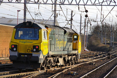 70005 heads south through Carlisle on the: 0K27 16:00 Carlisle Yard to Basford Hall 24/11/11