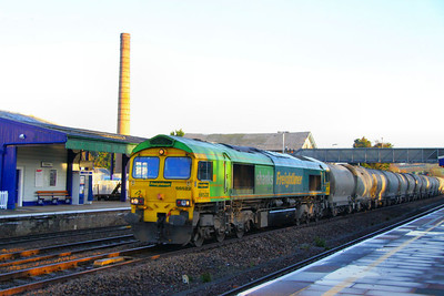 66522 in Shanks Livery heads west through Totnes on the: 6C17 06:53 Westbury Cement Works to Moorswater 02/12/11