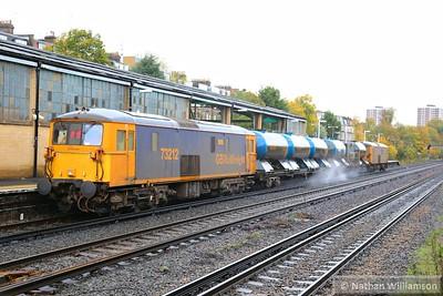 73212 heads north through Kensington Olympia on the rear of: 3W90 04:20 Horsham Yard to Horsham Yard  14/11/14