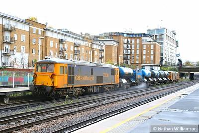 73136 heads south through Kensington Olympia on the rear of: 3W90 04:20 Horsham Yard to Horsham Yard 14/11/14  Watch the video at: http://youtu.be/0TqEqtxh01E