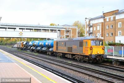 73212 heads south through Kensington Olympia on: 3W90 04:20 Horsham Yard to Horsham Yard 14/11/14  Watch the video at: http://youtu.be/0TqEqtxh01E