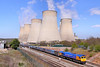 66721 heads south through East Midlands Parkway under Ratcliffe Power Station on the:<br /> 4M82 10:35 Drax to Hotchley Hill<br /> <br /> 21/04/10