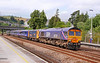 """66728 hauling 73206 heads north through Totnes with a rake of FGW Mk3 buffet cars for storage in Eastleigh, forming the: 5O66 10:00 Laira to Eastleigh Works. 73206 & 73212 were used as Mk3 barrier coaches for the move.<br /> <br /> The consist was:<br /> 73206 + 40736 40725 40726 40744 40738 40709 40745 + 73212<br /> <br /> Watch the video at: <a href=""""http://youtu.be/b3wo0L6TMqI"""">http://youtu.be/b3wo0L6TMqI</a>"""