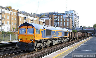 66737 heads north through Kensington Olympia on the: 6M94 11:09 Northfleet to Willesden Euroterminal  14/11/13