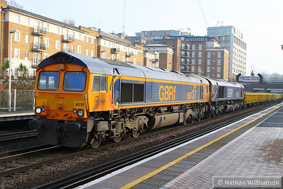 66737 & 66726 head north through Kensington Olympia on the: 6E40 09:44 Grain to Ferme Park  12/12/13