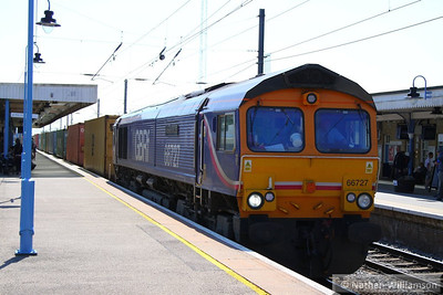 66727 heads north through Ely on the: 4E33 11:20 Felixstowe to Doncaster Railport  07/06/13