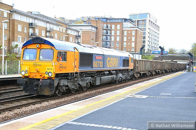 66710 heads north through Kensington Olympia working the: 6V93 11:10 Northfleet to Westbourne Park  21/11/13
