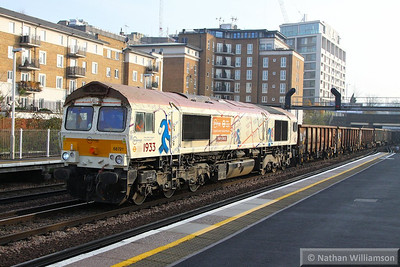 66721 heads north through Kensington Olympia on the: 6M94 11:10 Northfleet to Willesden Euroterminal  12/12/13