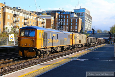 73213 & 73207 head north through Kensington Olympia working the: 6M94 11:09 Northfleet to Willesden Euroterminal 21/11/13  Watch the video at: http://youtu.be/Ma2TN_0HgRA