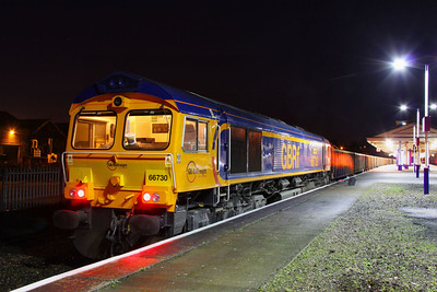 "66730 ""Whitemoor"" stands in Newton Abbot at 06:10am having ran round working the: 6C55 01:52 Newport Docks to Exeter Alphington Road   17/11/11"