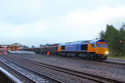 66718 stands in Newton Abbot at 06:40am in the wind and rain on the: 6F31 01:49 Cardiff Tidal to Exeter Alphington Road via Newton Abbot. This was the first day of the new GBRF Scrap Metal flow from Exeter Alphington Road. The loco has to run round at Newton Abbot in order to reverse the train onto the Alphington Road at Exeter St Thomas 06/09/11