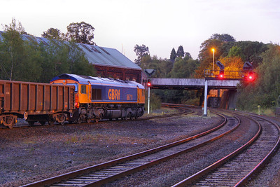 66711 stands in Newton Abbot at 06:20am at the crack of dawn to run round the:  6F31 22:56 Cardiff Tidal to Exeter Alphington Road  15/09/11