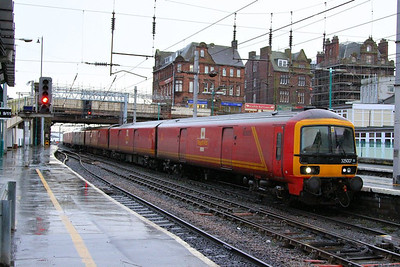 325007 heads south through Carlisle on the: 1M23 09:34 Shieldmuir to to Willesden Railnet  04/12/12
