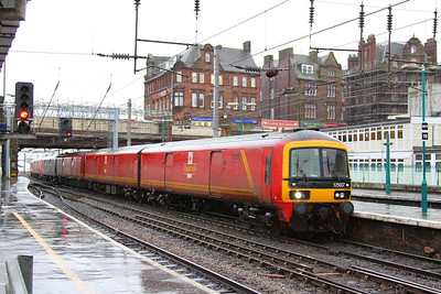 325007 heads south through Carlisle on the: 1M23 09:34 Shieldmuir to to Willesden Railnet  06/12/12